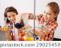 Delighted pretty girls enjoying their chemistry 29025459