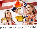 Cute joyful girls using scientific equipment 29025461