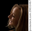 Portrait of a young woman on a black background 29033467