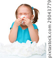 Little girl blows her nose 29043779