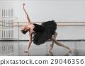 Beautiful ballerina sit on the twine in class 29046356