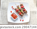 Grilled beef skewers with pepper and brussels 29047144