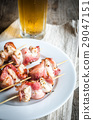 Grilled bacon skewers with chicken meat 29047151