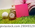 golf ball , watch and blank note are on green gras 29049329