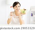 beautiful  young woman eating healthy food 29053329