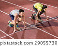 Male and female athlete in starting position 29055730