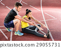 Man and woman on cinder track of sports arena  29055731