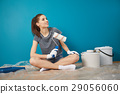 bright picture of lovely housewife painting at home 29056060