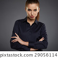 Portrait of a beautiful young business woman standing against gr 29056114