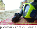 Green Snorkel and Diving mask on Mat at the sea. 29056411