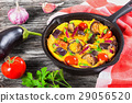 scrambled eggs and vegetables in frying pan  29056520