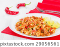 cooked and marinated Pig Ears on white platter 29056561