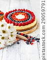 Raspberry and blueberry cheesecake on wooden table 29059791