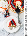Raspberry and blueberry cheesecake on wooden table 29059797