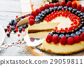 Raspberry and blueberry cheesecake on wooden table 29059811