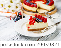Raspberry and blueberry cheesecake on wooden table 29059821