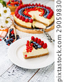 Raspberry and blueberry cheesecake on wooden table 29059830