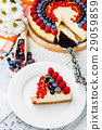 Raspberry and blueberry cheesecake on wooden table 29059859