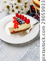 Raspberry and blueberry cheesecake on wooden table 29059933