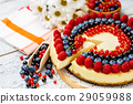 Raspberry and blueberry cheesecake on wooden table 29059988