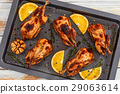 whole quails grilled in roasting dish with thyme 29063614