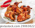 grilled whole quails with thyme on dish 29063622