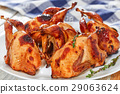 barbeque quails with thyme on dish on white table 29063624