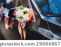 Door of black wedding car with flowers and white 29064867
