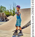 Girl roller skate helmet walking park. Child 29065140