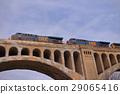 locomotive, stone bridge, freight train 29065416