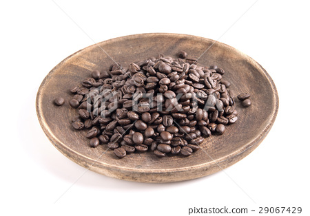 Coffee beans in wooden dish. 29067429