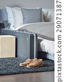 shoes and luggage on black rug in modern bedroom 29071387