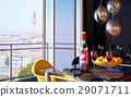 Red wine bottle in a tray with two wine glasses and an open window on Florence panorama. 29071711