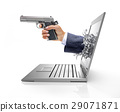 Human hand with gun, splashing out from computer screen. 29071871