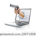 Man's hand holding gun, splashing out from laptop screen. 29071908