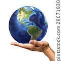 Man's hand with earth globe on it. On white background 29071930
