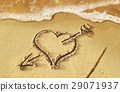 Heart with arrow, as love sign, drawn on the beach shore, with some water and foam coming from the sea. 29071937