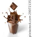 Chocolate cubes splashing into a chocolate milkshake glass. 29072135