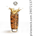 Ice cube falling into a tall glass, splashing. 29072137