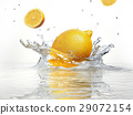 lemon splashing into clear water 29072154