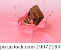 Chocolate blocks splashing into a pink milkshake. 29072184