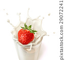 Strawberry falling into a glass of milk creating a splash. 29072241