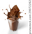 Chocolate cubes splashing into a chocolate milkshake glass. 29072262