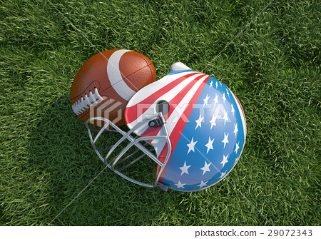 American football helmet decorated as US flag and ball, on the grass. Close up. 29072343