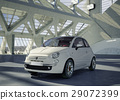 Fiat 500 city car, alone in the middle of a huge modern building environment. 29072399