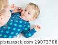 Mother hand cleaning baby ear 29073706