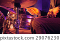 Drummer plays on drum set and cymbal 29076230