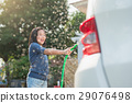 Asian children washing car 29076498