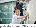 Asian children washing car 29076512
