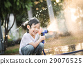 asian boy has fun playing in water 29076525